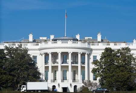 neoclassical: White House with white truck making a delivery parked in front.