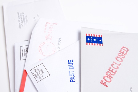 tough times: Small group of envelopes marked PAST DUE and FORECLOSED.  Suggesting tough economic times US. Stock Photo