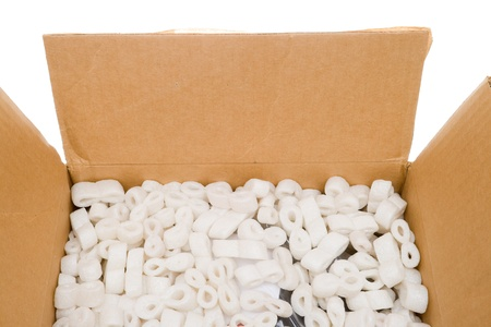 Looking into a box of packing peanuts.  Isolated on white background. photo