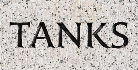 single word: Single word tanks carved in stone.