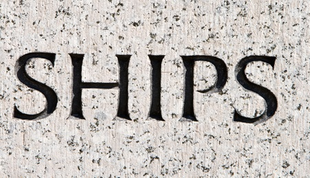 The word ships carved in granite. photo
