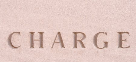 single word: Single word Charge carved in stone.
