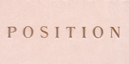 single word: Single word position carved in sandstone Stock Photo