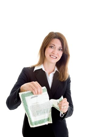 stock certificate: Caucasian businesswoman tearing stock certificate.  Stock market crash theme. Stock Photo