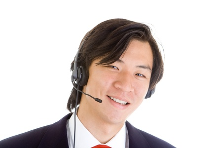 Asian man in a suit with headset looking at the camera. Isolated on white background photo
