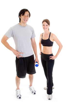 full body shot: Asian man and Caucasian woman in work out clothing isolated on white.  Full body shot.
