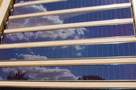 Louvered solar panels reflecting the sky. photo