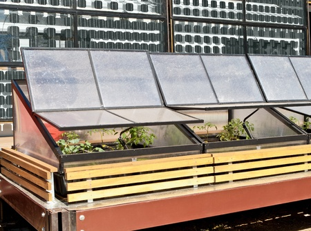 Greenhouse cold frame and solar panels. photo