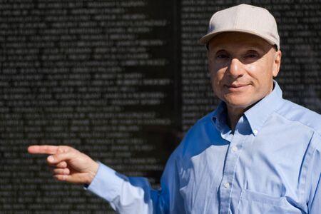 adult vietnam: Vietnam veteran pointing to a friend