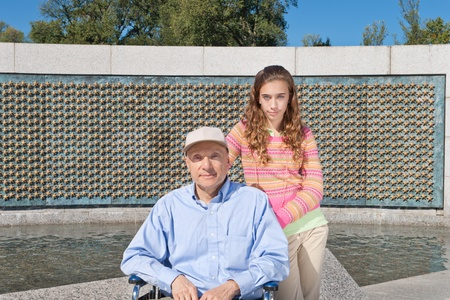 world war two: Grandfather and granddaughter at WWII Memorial, in Washington, DC