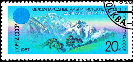 franked: USSR- CIRCA 1987:  A stamp printed in the USSR shows Donguzorun and Nakra-tau mountains in the Caucasus, circa 1987.
