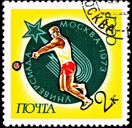 typically: USSR- CIRCA 1973:  A stamp printed in the USSR shows a man throwing a hammer, typically known as the hammer throw, circa 1973. Stock Photo