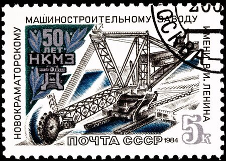 USSR- CIRCA 1984:  A stamp printed in the USSR commemorating the 50th anniversary of the Novokramatorsk Machinery Plant shows a cantilevered open pit mining machine, circa 1984.