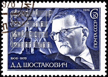 franked: USSR- CIRCA 1976:  A stamp printed in the USSR shows a portrait of the Russian composer Dmitri Shostakovich and the score for his 7th Symphony, circa 1976.