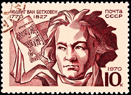 cancellation: USSR- CIRCA 1970:  A stamp printed in the USSR shows a portrait of Ludwig Von Beethoven and a score marked Allegro Assai, circa 1970.