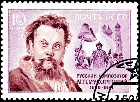 petrovich: USSR- CIRCA 1989:  A stamp printed in the USSR shows Modest Mussorgsky a Russian composer, some bells and the Kremlin, circa 1989. Stock Photo