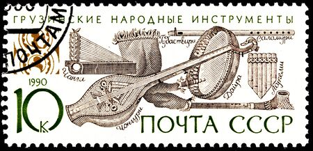 franked: USSR - CIRCA 1990:  A stamp printed in the USSR shows Georgian folk music instruments, circa 1990. Stock Photo
