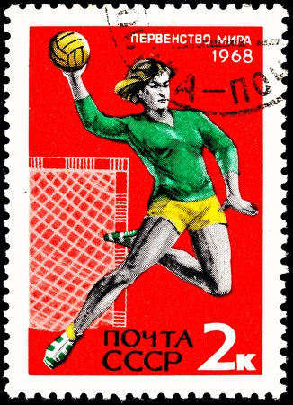 franked: USSR- CIRCA 1967:  A stamp printed in the USSR shows a young woman leaping and throwing a handball, circa 1967.