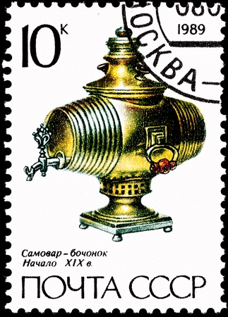 decorative urn: USSR - CIRCA 1989:  A stamp printed in the USSR shows a brass barrel keg shaped samovar from the early 1800
