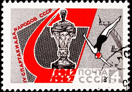 franked: USSR - CIRCA 1967:  A stamp printed in USSR shows a woman diving from the high dive during the Spartakiad or Spartacus Games, a Soviet Alternative to the Olympics, circa 1987. Stock Photo