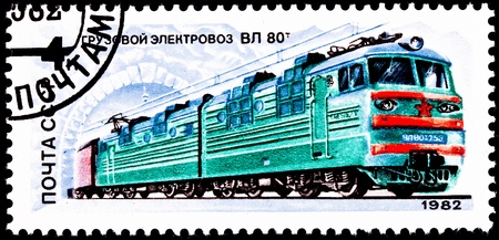 franked: USSR- CIRCA 1982:  A stamp printed in the USSR shows a TUL-80 electric locomotive emerging from a tunnel, circa 1982. Stock Photo