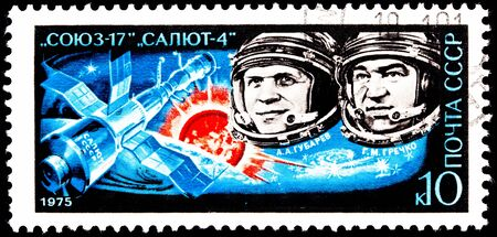 franked: USSR- CIRCA 1975:  A stamp printed in the USSR shows Aleksei Gubarev and Georgy Grechko aboard  Soyuz 17, circa 1975. Stock Photo