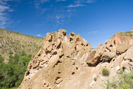 pitting: Tuff Ash deposits from the eruption of the Valles Caldera, Bandelier National Monument New Mexico.  Deposits are hundreds of feet think