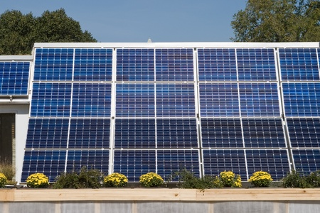 pv: PV solar panel array  with a blue sky in the background. Stock Photo