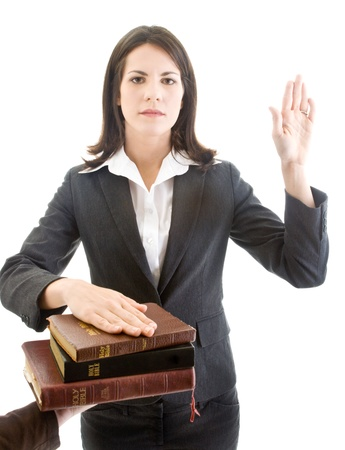 Caucasian Woman Swearing on a Bible Isolated White Background photo