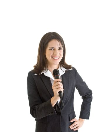 Happy Caucasian business woman holding a microphone and smiling at the camera.  White Background. photo