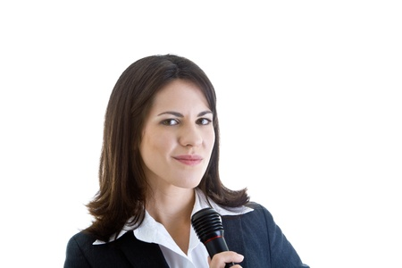 smirking: Caucuasian woman smirking at camera while holding microphone.  Isolated on a white background.