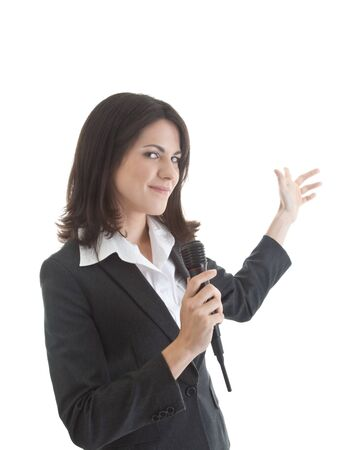 Smiling Caucasian woman holding wireless microphone and gesturing behind herself.   Isolated on white background. Stock Photo - 11397308