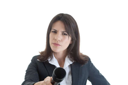 Skeptical woman holding a microphone out to the camera photo