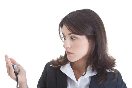 White woman looking at a compass with alarmed expression.  Isolated on white.
