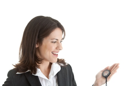 Happy Caucasian woman in a suit looking at a compass.  Isolated on white background. Stock Photo - 11397382