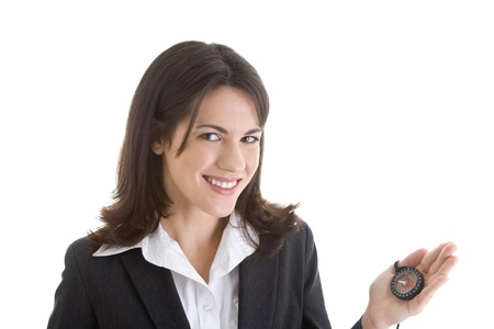 Happy white businesswoman smiling at camera while holding a compass. Stock Photo - 11397381