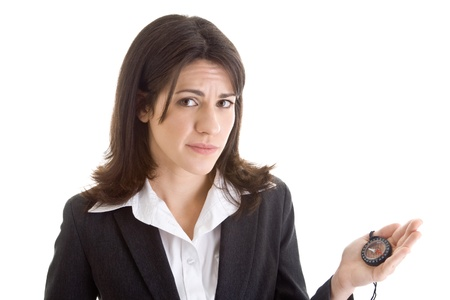 business skeptical: Worried Caucasian woman holding a compass with a puzzled expression. Stock Photo