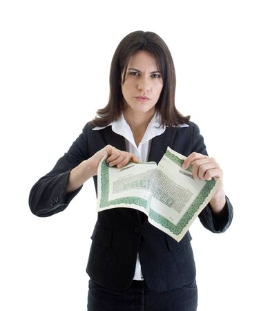 Angry Caucasian woman glaring at the camera while ripping up a stock certificate.  Isolated on white. Stock Photo - 11397318