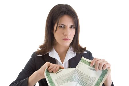 Angry Caucasian woman glaring at the camera while ripping up a stock certificate.  Isolated on white.