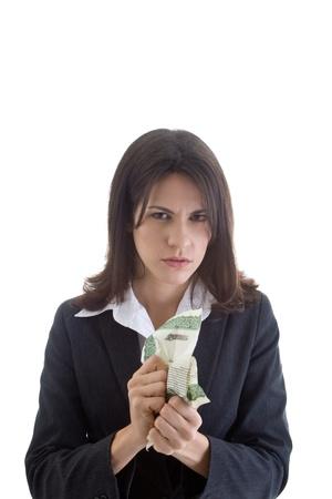 stock certificate: Mujer de raza cauc�sica enojado mirando a la c�mara mientras se aplastaba un certificado de acciones. Aislado en blanco. Foto de archivo