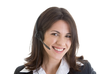 Young Caucasian woman wearing a telephone headset and smiling at the camera. photo