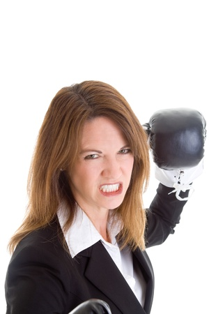 grimacing: Young white woman grimacing as she punches the camera Stock Photo