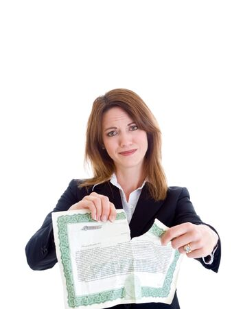 Caucasian woman tearing up a stock certificate.  Isolated on white background.  Bad investment theme.