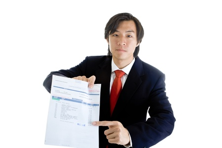 medical bill: Asian man in a suit pointing at a medical bill marked past due. Various medical codes related to a CT scan.