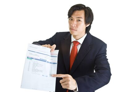 medical bill: Asian businessman pointing at past due medical bill with dunning expression.  Isolated on white background.