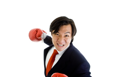 gritting: Angry Asian man in a suit with boxing gloves gritting teeth ready to punch the camera Stock Photo