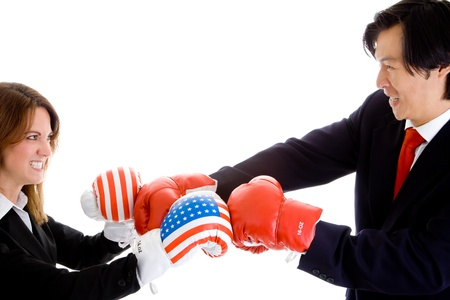 Caucasian Woman and Asian Man Boxing with Boxing Gloves in Suits.  Woman