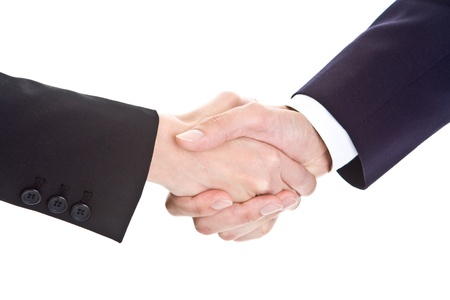 grip: Male and female hands shaking.  Sleeves are business suits.  Isolated on white background.