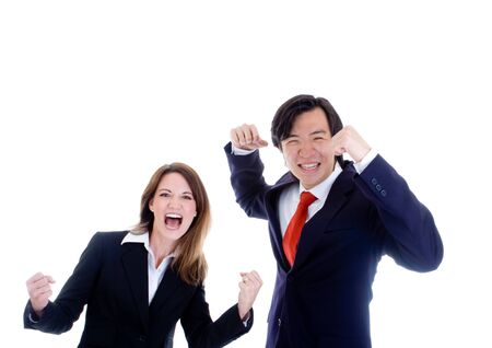 White businesswoman and Asian businessman cheering photo