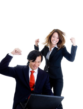 jump suit: Caucasian woman and Asian man in business suits, happy about something on a laptop.  Isolated on white background Stock Photo